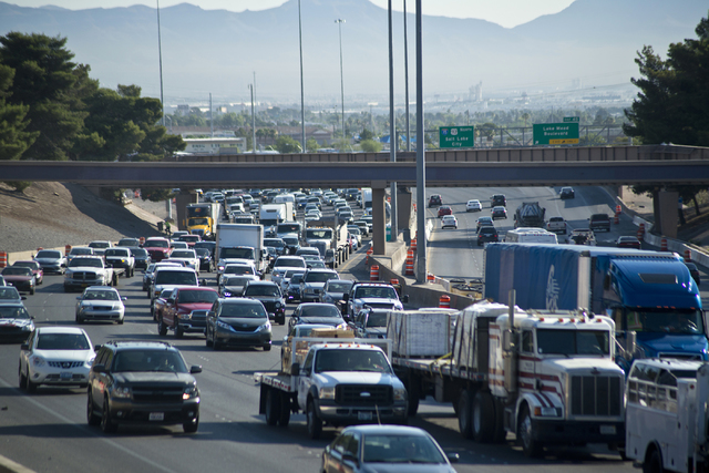Traffic is backed up on southbound Interstate 15 in downtown Las Vegas as Electric Daisy Carnival festival-goers mingle with the morning commute Monday, June 20, 2016. (Daniel Clark/Las Vegas Revi ...