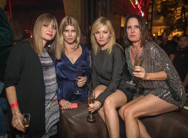 Elisha Cuthbert, third from left, and Lee-Ann Cuthbert, second from left, Saturday at club XS. (Tony Tran.)