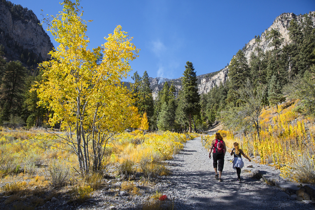 Ashley Knutson, left, and Madelynne Smith hike up the Mary Jane Falls trail on Wednesday, Oct. 5, 2016, on Mount Charleston. (Benjamin Hager/Las Vegas Review-Journal)