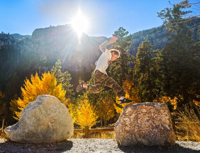 Samuel Sosa leaps from one rock to another at the foot of Mary Jane Falls trail on Wednesday, Oct. 5, 2016, on Mount Charleston. (Benjamin Hager/Las Vegas Review-Journal)