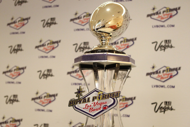 The Royal Purple Las Vegas Bowl trophy is seen during a press conference at the Royal Purple Las Vegas Bowl headquarters in Las Vegas, Sunday, Dec. 7, 2014. Colorado State University is set to pla ...