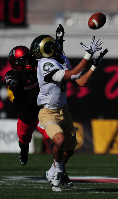 Colorado State Rams wide receiver Olabisi Johnson (81) catches a pass for a first down as UNLV Rebels defensive back Darius Mouton (21) defends in the first half of their NCCA college football gam ...
