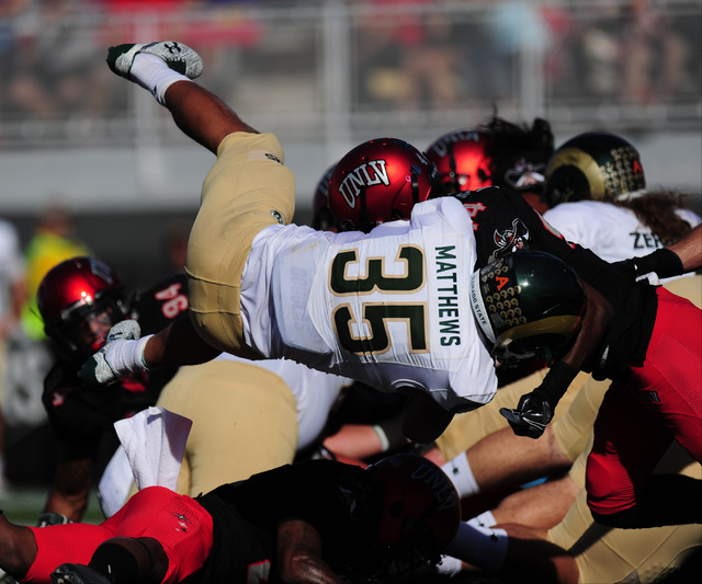 Colorado State Rams running back Izzy Matthews (35) dives into the endzone to score a touchdown against UNLV in the first half of their NCCA college football game at Sam Boyd Stadium Saturday, Oct ...