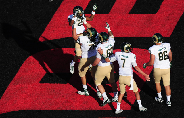 Colorado State Rams offensive lineman Nick Callender (76) hoists running back Marvin Kinsey Jr. (25) after Kinsey Jr. scored a touchdown against UNLV in the first half of their NCCA college footba ...
