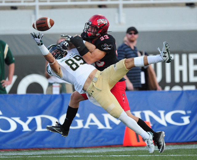UNLV Rebels defensive back Dalton Baker (33) breaks up a pass intended for Colorado State Rams wide receiver Robert Ruiz (89) in the second half of their NCAA college football game at Sam Boyd Sta ...