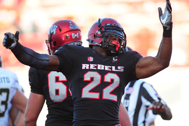 UNLV Rebels running back David Greene (22) celebrates after scoring a touchdown while being wrapped against Colorado State in the second half of their NCCA college football game at Sam Boyd Stadiu ...