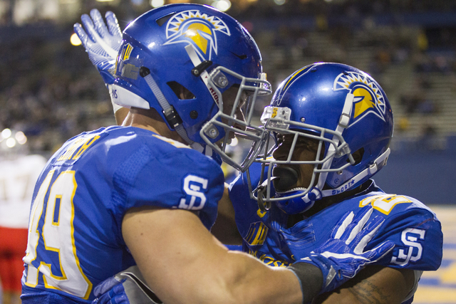 San Jose State Spartans running back Shane Smith (49) celebrates a touchdown by wide receiver Tim Crawley (2) in their football game against the UNLV Rebels in their football game at CEFCU Stadium ...