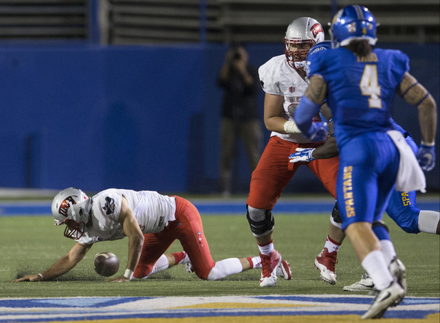 UNLV Rebels quarterback Kurt Palandech (14) drops the ball during a play against the San Jose State Spartans in the football game at CEFCU Stadium on Saturday, Oct. 29, 2016, in San Jose. Erik Ver ...