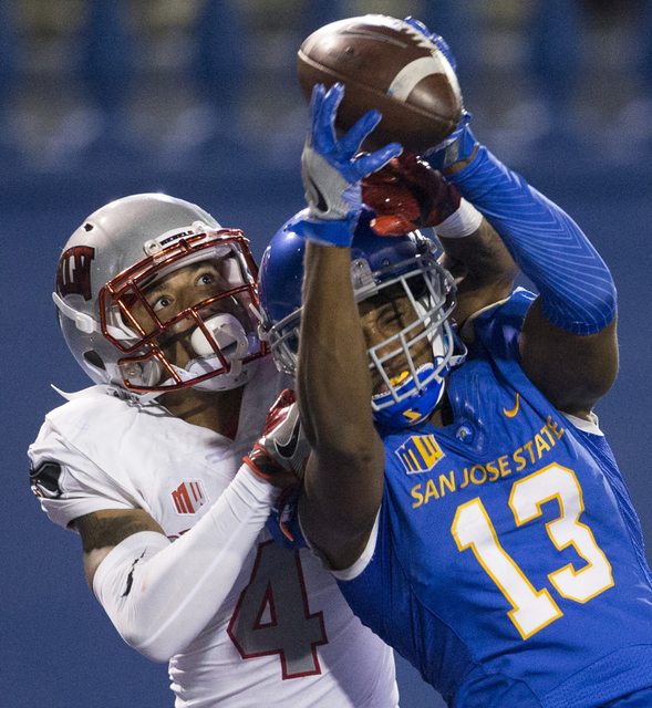 San Jose State Spartans wide receiver Tre Hartley (13) makes a catch for a touchdown against UNLV Rebels defensive back Torry McTyer (4) in their football game at CEFCU Stadium on Saturday, Oct. 2 ...