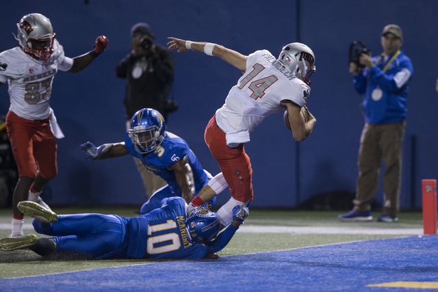 UNLV Rebels quarterback Kurt Palandech (14) runs the ball for a touchdown against the San Jose State Spartans in their football game at CEFCU Stadium on Saturday, Oct. 29, 2016, in San Jose. The S ...