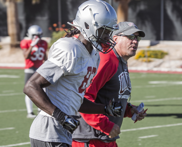 UNLV football coach Tony Sanchez, right, jogs back to the huddle with wide receiver Devonte Boyd during practice on Tuesday, Oct. 4, 2016.(Jeff Scheid/Las Vegas Review-Journal) Follow @jeffscheid