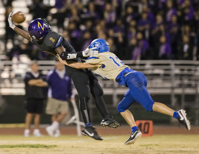 Durango wide receiver Justice Stroy (2) leaps to try and make a reception over Sierra Vista defender Trevor Gentner (12) on Friday, Oct. 21, 2016, at Durango High School, in Las Vegas. Benjamin Ha ...