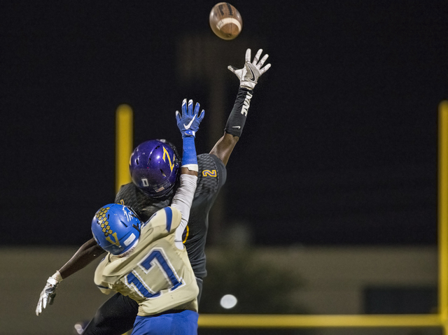 Durango wide receiver Justice Stroy (2) extends to try and make a reception over Sierra Vista defender Robert Butler (17) on Friday, Oct. 21, 2016, at Durango High School, in Las Vegas. Benjamin H ...