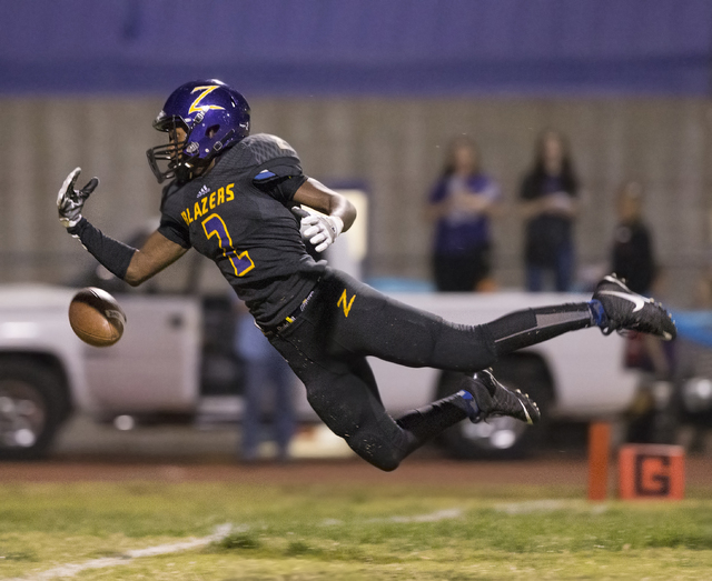 Durango wide receiver Justice Stroy (2) leaps to try and make a diving catch on Friday, Oct. 21, 2016, at Durango High School, in Las Vegas. Benjamin Hager/Las Vegas Review-Journal