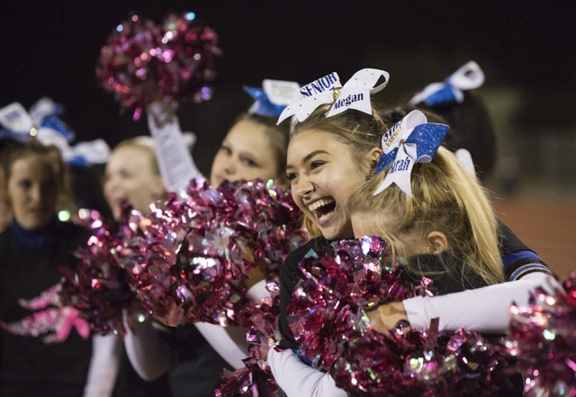 Sierra Vista senior cheerleader  Megan Lynes celebrates with her squad after the Mountain Lions defeated Durango to go to 8-0 on the season on Friday, Oct. 21, 2016, at Durango High School, in Las ...