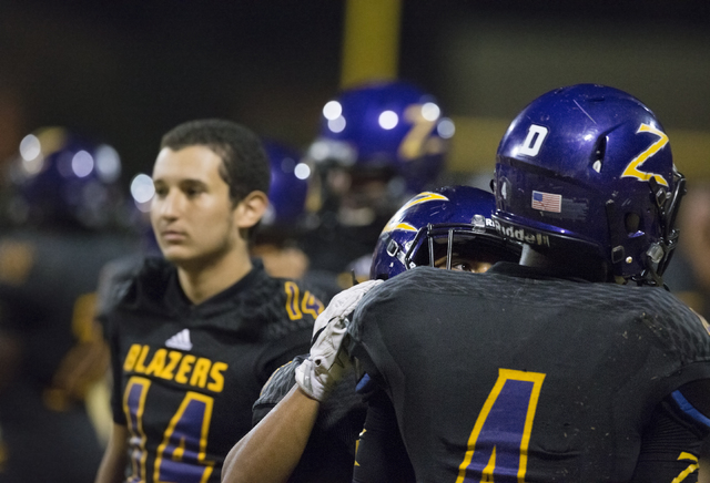 Durango running back Boogie Kamara (4) is consoled by teammates after the loss to Sierra Vista on Friday, Oct. 21, 2016, at Durango High School, in Las Vegas. Benjamin Hager/Las Vegas Review-Journal