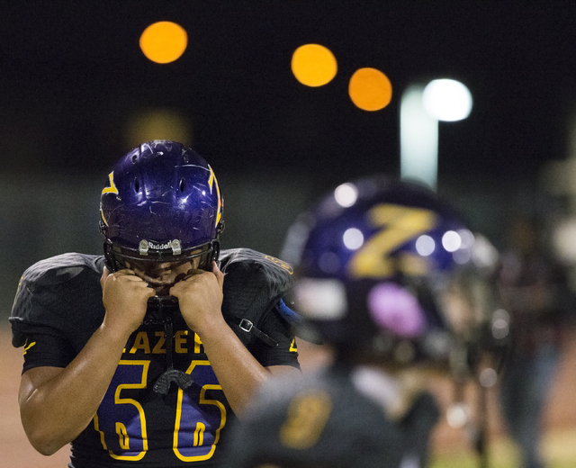 Durango's Kale Kuhiiki (66) tries to gather himself after the loss to Sierra Vista on Friday, Oct. 21, 2016, at Durango High School, in Las Vegas. Benjamin Hager/Las Vegas Review-Journal