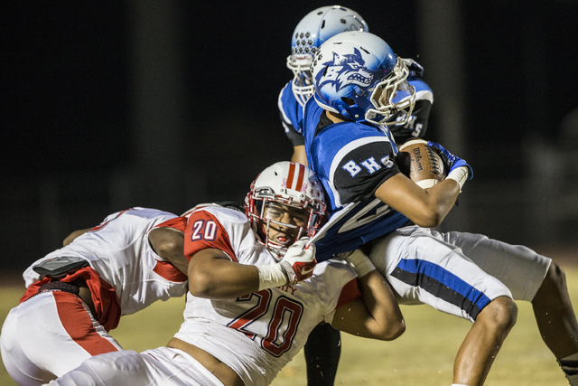 Liberty's Tamakave Tai  (20 ) tackles Basic's Jordan Gallegos (25) on Thursday, Oct. 27, 2016, at Basic High School in Henderson. (Benjamin Hager/Las Vegas Review-Journal)