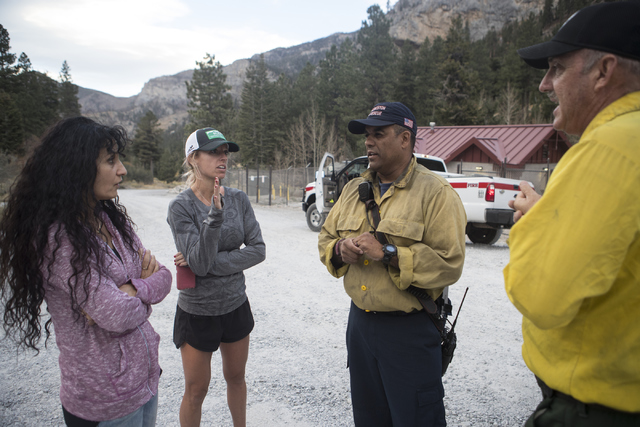 Concern Mount Charleston residents, Mona Orkoulas, from left, Stephanie Ibasco speak with Fire Chief for the Mount Charleston Fire Protection District Jorge Gonzalez and United States Forest Servi ...