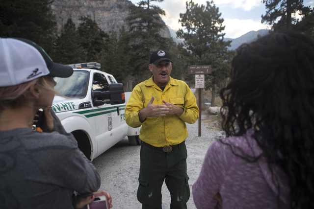 Concern Mount Charleston residents, Mona Orkoulas, from left, Stephanie Ibasco speak with United States Forest Service Prevention Officer Ray Johnson on Friday, Oct. 14, 2016. Loren Townsley/Las V ...