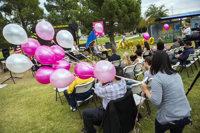 Catherine Lu holds on to balloons at West Flamingo Park during a  news conference announcing the completion of the $46.4 million overhaul of Flamingo Road on Friday, Oct. 28, 2016.(Jeff Scheid/Las ...
