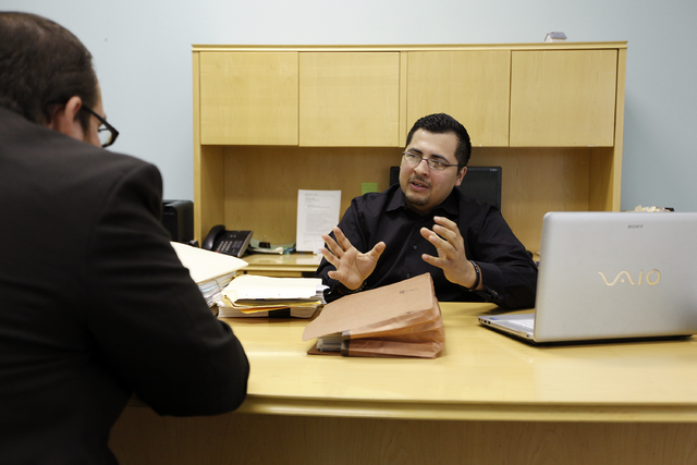 Edgar Flores, right, meets with Gil Lopez at the Jeglaw law firm in Las Vegas Wednesday, March 19, 2014. Flores was the only candidate to file to run for Assembly District 28. (John Locher/Las Veg ...