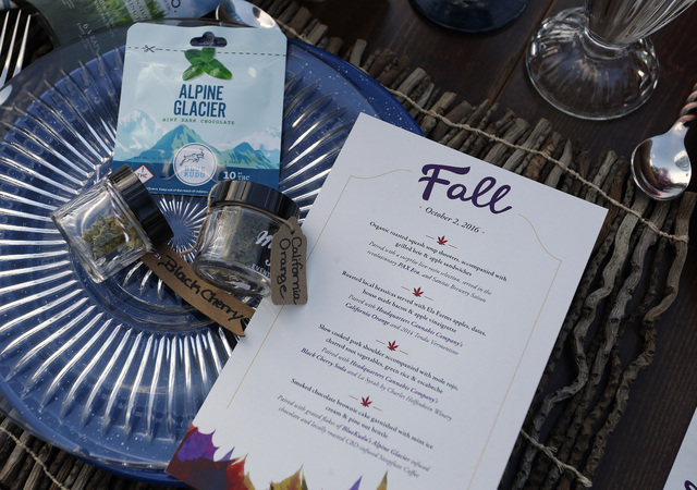 A menu shows the dishes paired with certain strains of pot during an evening of pairings of fine food and craft marijuana strains served to invited guests dining at Planet Bluegrass, an outdoor ve ...