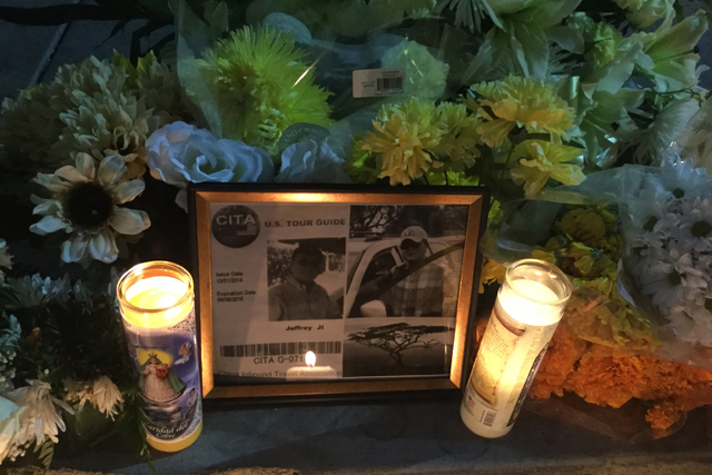 A candlelight vigil for Fuli Ji, 52, of Chino Hills Calif., was held near the Caesar's Palace employee parking garage in Las Vegas, Nev. on Tuesday, Oct. 25, 2016. (Raven Jackson/Las Vegas Review- ...