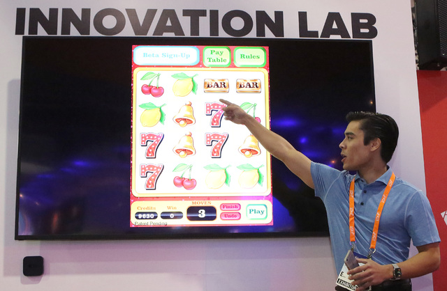 Troy Pettie, UNLV student and Guru Games founder, demonstrates Line em Up game he invented  with Troy Pettie during Global Gaming Expo Tuesday, Sept. 27, 2016, at the Sands Expo and Convention Cen ...