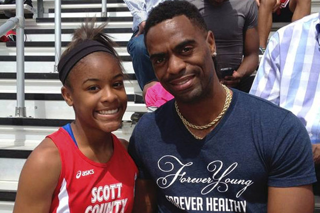 Trinity Gay poses with her father U.S. sprinter Tyson Gay in May. (Mark Maloney/Lexington Herald-Leader via AP)