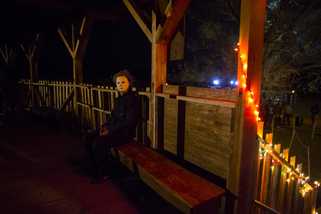 """A costumed actor waits to scare visitors during """"Bonnie Screams"""" at Bonnie Springs Ranch outside of Las Vegas on Tuesday, Oct. 25, 2016. (Chase Stevens/Las Vegas Review-Journal Follow @csstevensphoto)"""