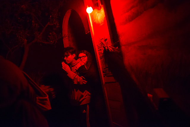 """Visitors huddle together while walking through an attraction during """"Bonnie Screams"""" at Bonnie Springs Ranch outside of Las Vegas on Tuesday, Oct. 25, 2016. (Chase Stevens/Las Vegas Review-Journal ..."""