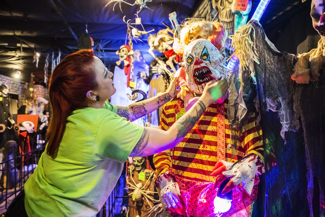 HalloweenMart employee Amber Rios adjusts a clown mask at the store, 6230 S. Decatur Blvd., Suite 101, Sept. 29, 2016, in Las Vegas. The costume shop is open year round and offers inventory for ev ...