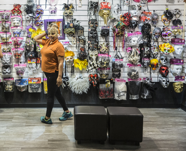 Lupe Vanaga tries on a mask at HalloweenMart Sept. 29, 2016, in Las Vegas. Benjamin Hager/View