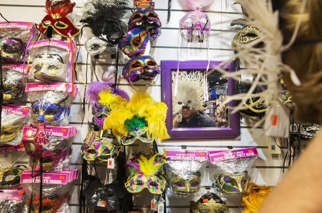 Mark Hanks looks at a mask in the mirror at HalloweenMart Sept. 29, 2016, in Las Vegas. Benjamin Hager/View