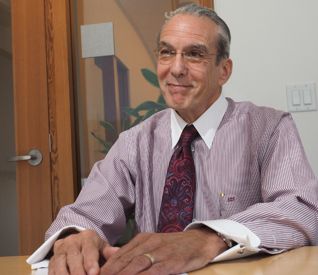 Dr. Jeffrey Cummings, medical director for the Lou Ruvo Center for Brain Health, pauses while speaking about his hopes for Alzheimer's disease treatments during an interview in his office at the R ...