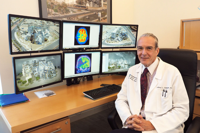Dr. Jeffrey Cummings, medical director for the Lou Ruvo Center for Brain Health, poses in front of a multi-computer display during an interview in his office at the Ruvo Center in Las Vegas, Monda ...