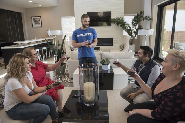 Johnny Skandros, center, founder of gay dating app Scruff, hangs out with family and friends from left, Misha Vansluis, mother Stephanie Skandros, Zar Zanganeh and Vanessa Brennan at his home in L ...