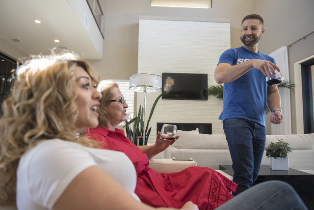 Johnny Skandros, right, founder of gay dating app Scruff, hangs out with his family and friends from left, Misha Vansluis and mother Stephanie Skandros at his home in Las Vegas on Tuesday, Oct. 18 ...