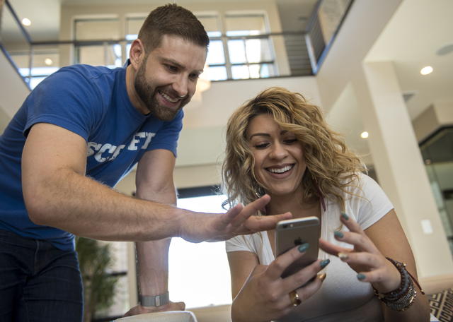 Johnny Skandros, left, founder of gay dating app Scruff, looks at profiles on his app with friend Misha Vansluis at his home in Las Vegas on Tuesday, Oct. 18, 2016. Martin S. Fuentes/Las Vegas Rev ...