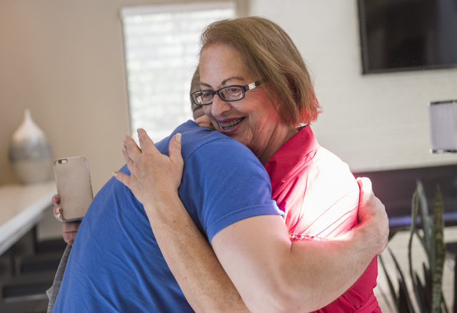 Johnny Skandros, left, founder of gay dating app Scruff, hugs his mom Stephanie Skandros at his home in Las Vegas on Tuesday, Oct. 18, 2016. Martin S. Fuentes/Las Vegas Review-Journal