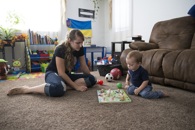 Yuliya Usyk plays with her 1-year-old son Matthew Genco at their home on Thursday, Sept. 29, 2016, in Las Vegas. Usyk, a Ukranian immigrant who grew up speaking Russian, now teaches her son the la ...