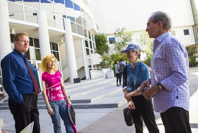 Jean Sternlight, director of the Saltman Center for Conflict Resolution, third from left, with Michael Saltman, far right, talk with people outside of the William S. Boyd School of Law at UNLV in  ...