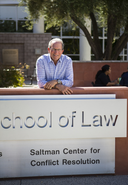 Michael Saltman, managing general partner and president of The Vista Group, poses for a photo next to a sign for the Saltman Center for Conflict Resolution outside of the William S. Boyd School of ...