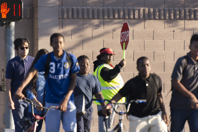 Crossing guards Rhonda Enabulele assists children in crossing Lake Mead Boulevard at Tonopah Drive before classes at West Preparatory Academy in Las Vegas, Thursday, Oct. 6, 2016. (Jason Ogulnik/L ...