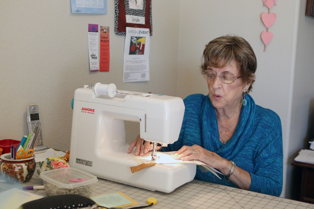 Loretta Eichelberger, 86, sews on the sewing machine at her North Las Vegas home Wednesday, Oct. 5, 2016. Eichelberger lives a full life quilting, gardening, going to school, volunteering, and wor ...