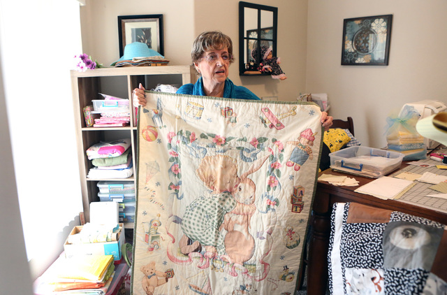 Loretta Eichelberger, 86, displays baby quilt she has made at her North Las Vegas home Wednesday, Oct. 5, 2016. Eichelberger lives a full life quilting, gardening, going to school, volunteering, a ...