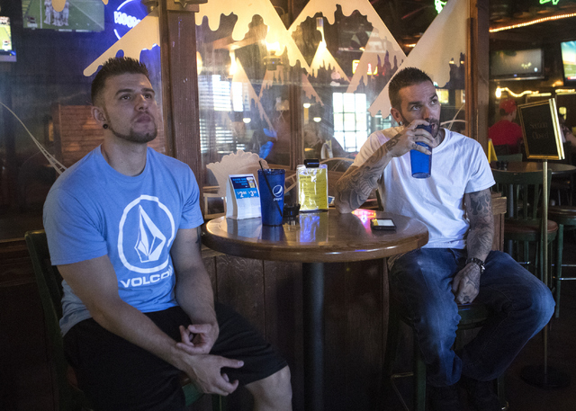 Brandon Moran, left and Jacob McCulloch watch football at the Santa Fe Mining Company in Las Vegas on Saturday, Oct. 1, 2016. McCulloch donated his kidney to Brandon last year. (Loren Townsley/Las ...