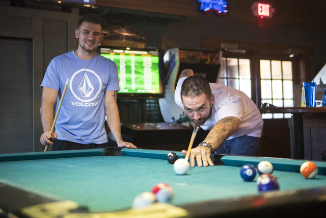 Brandon Moran, left and Jacob McCulloch play pool at the Santa Fe Mining Company in Las Vegas on Saturday, Oct. 1, 2016. McCulloch donated his kidney to Brandon last year. (Loren Townsley/Las Vega ...
