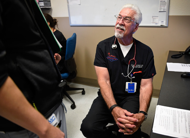 University Medical Center Chief of Staff Dr. Dale Carrison is consulted by a resident doctor in a dictation room at the hospital Monday, Oct. 24, 2016, in Las Vegas. Carrison, a 26-year veteran at ...